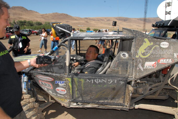 Del Albright photo of Shannon Campbell of Ultra4 being interviewed by Lance Clifford.
