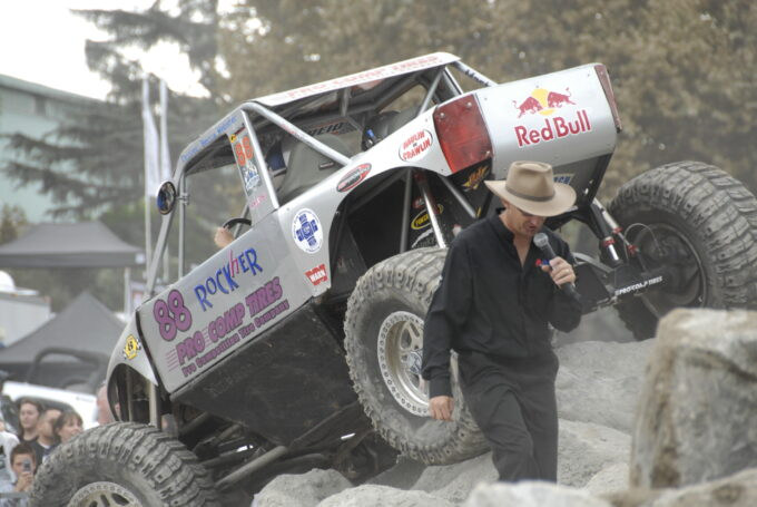 Del Albright photo of Dustin Webster announcing at rock crawling event.