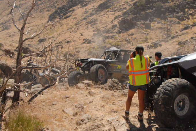 Del Albright photo of Stacie Albright being media at rock crawling event, Exit 28, Stampede