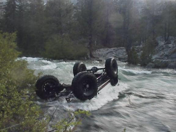 Kurt Schneider pic of rollover in river for ModernJeeper