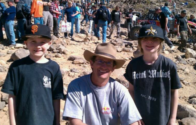ModernJeeper Kurt Schneider sons posing with Dustin Webster at rock crawling event. Kids love races.